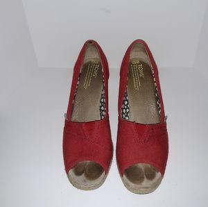 Tom's red wedge heels